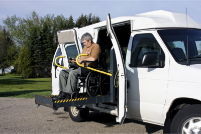 elderly man in a wheelchair using van lift